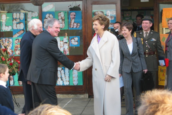 Chairperson of the Board of Management, Fr. Gay Colleran and Principal, Mr. Dermot Lynch greet President McAleese (2005)
